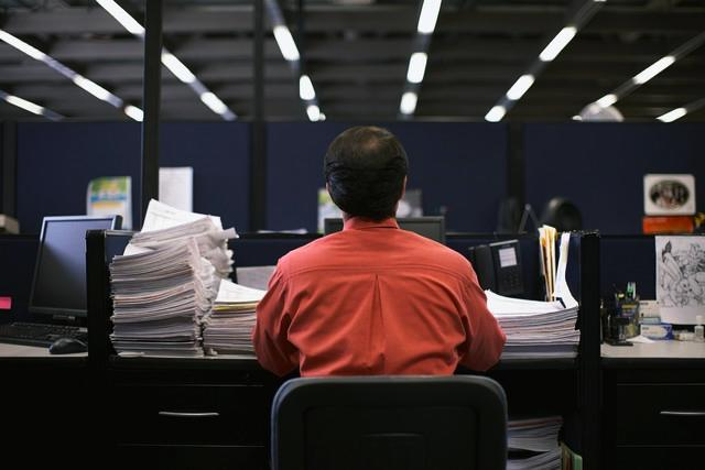 Businessman Working at Desk, photo by Todd Warnock/Corbis