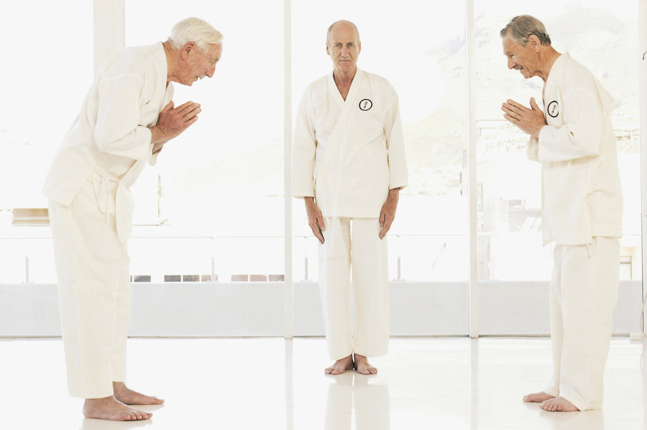 Three men wearing martial arts uniforms, Tomas Rodriguez/Corbis