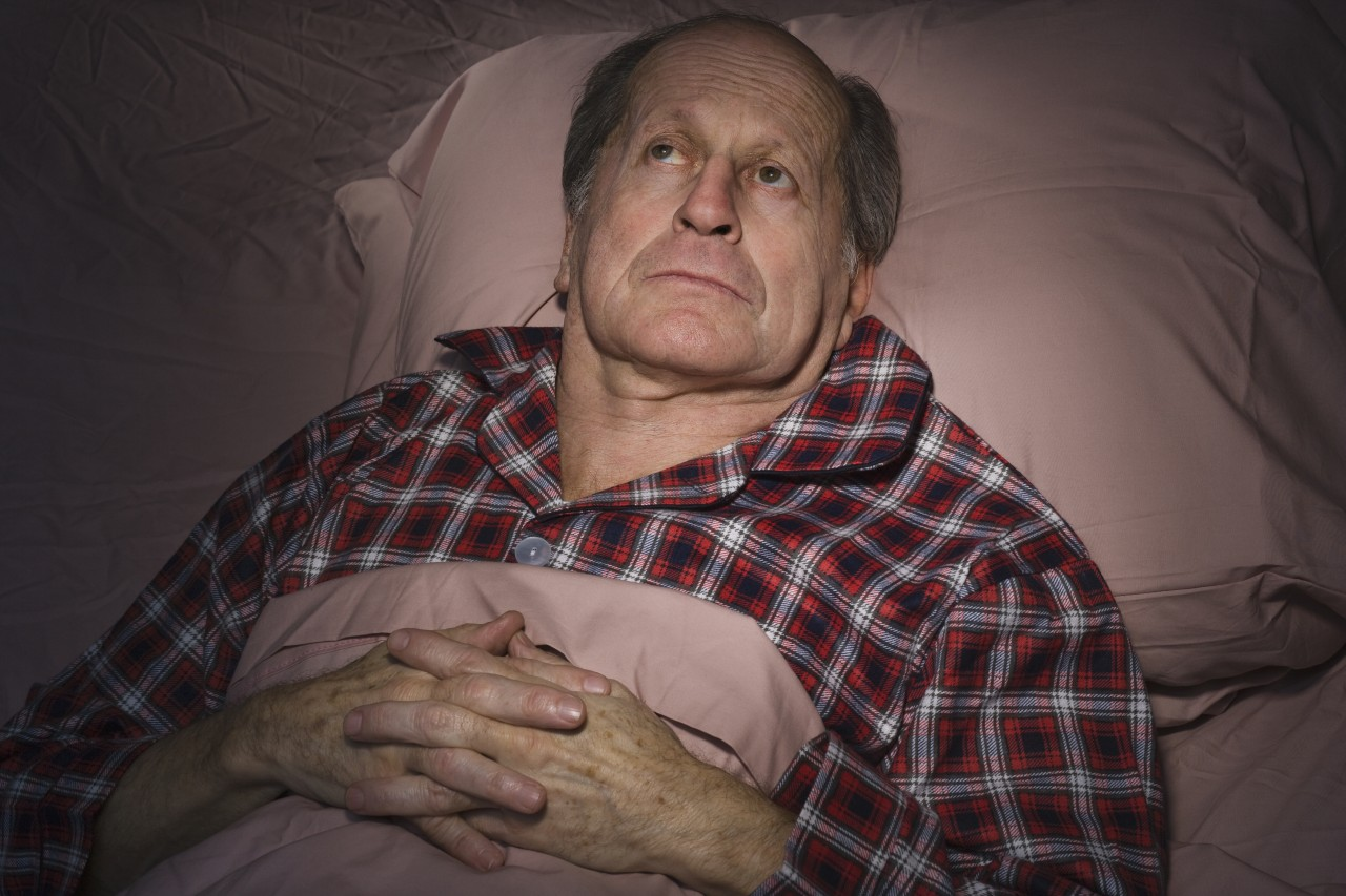 Man having trouble sleeping, Steve Prezant/Blend Images/Corbis