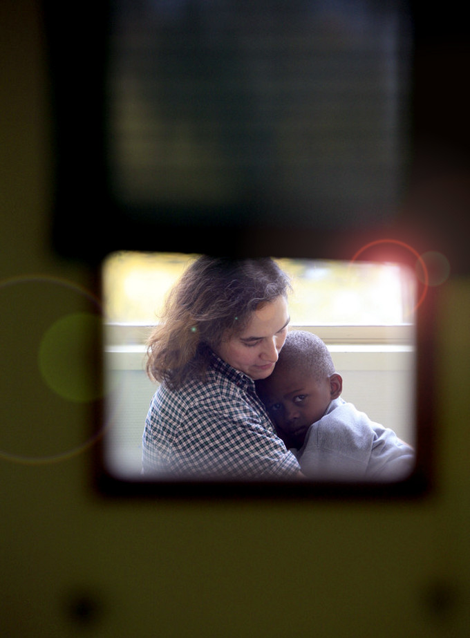 Foster Mother Holding Sick Child, Philippe Lissac /Godong/Corbis