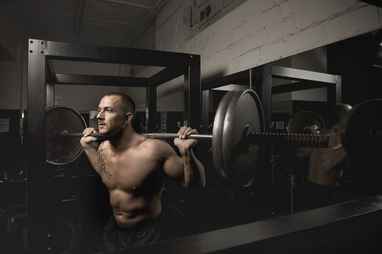 Man Doing Barbell Squats, Daams Naber/Corbis