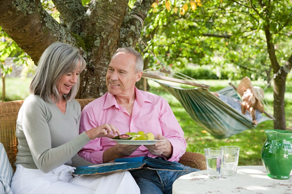 Mature couple eating from plate of food --- Image by © Image Source/Corbis