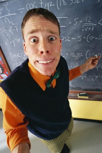 Stressed Teacher at Chalkboard, Image by LWA-Dann Tardif/CORBIS