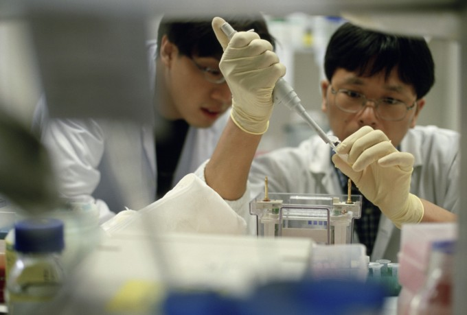 Singapore - Doctors in Laboratory, Image by Justin Guariglia/Corbis