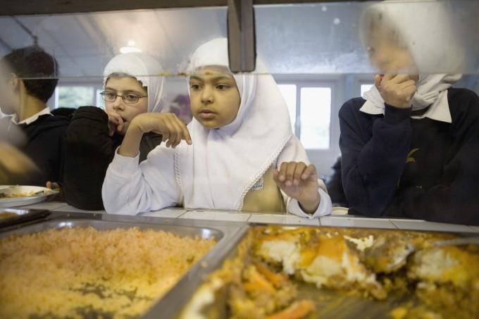 Muslim Schoolchildren Waiting in Cafeteria
