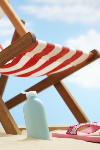 Sunscreen and Deck Chair, Image by © moodboard/Corbis