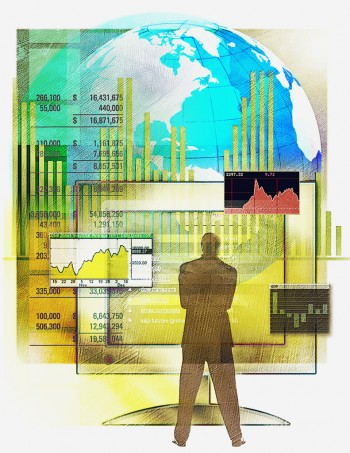 A Man Monitoring the Global Sales Volumes, Image by © Images.com/Corbis