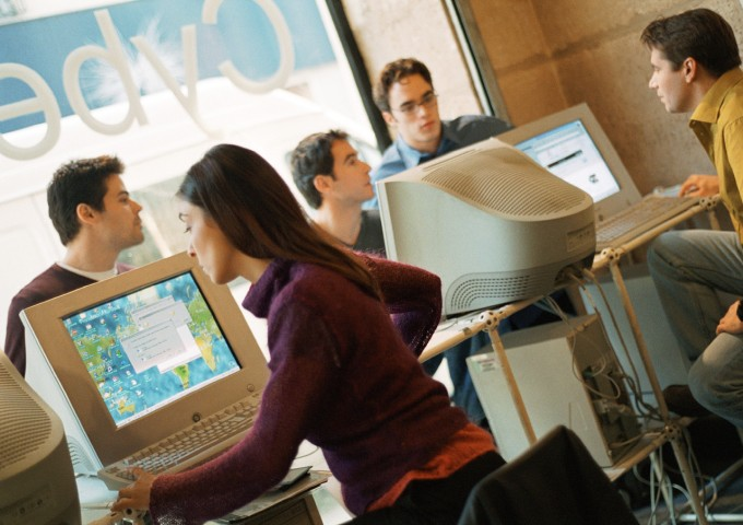 People In Cyber Cafe, Image by © Eric Audras/PhotoAlto/Corbis