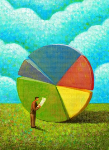A businessman looking at a pie chart, Image by © ImageZoo/Corbis