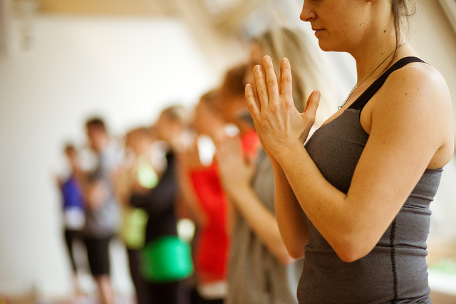 Hands at the heart centre, photo by lululemon athletica