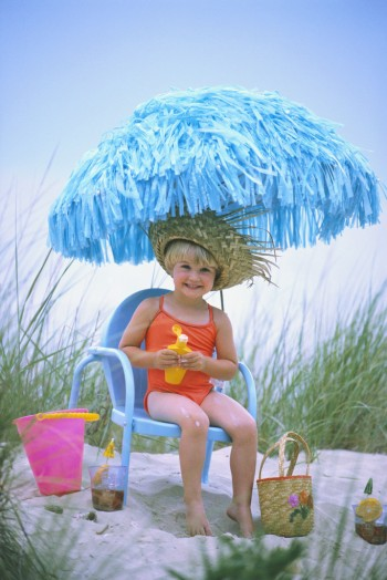 Girl Applying Sunscreen, Image by © Ariel Skelley/CORBIS