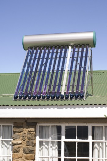 Rooftop solar water heater, Image by © Stuart Cox/Arcaid/Corbis